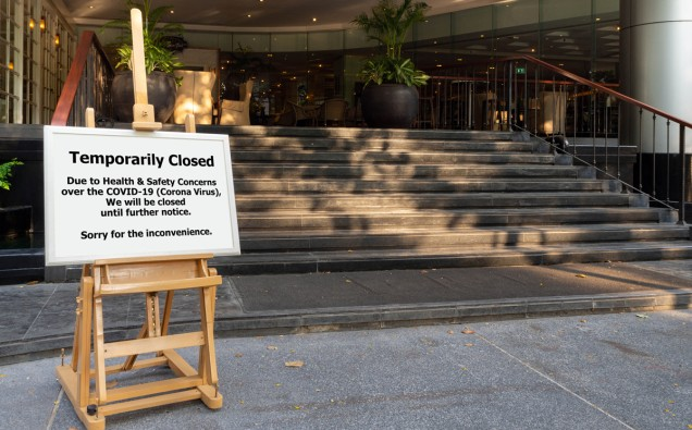 Bangkok, Thailand - April 17, 2020 : restaurant, hotel, company, shopping center closed due to coronavirus or covid-19 pandemic outbreak lockdown. coronavirus news temporarily closed board in front of building after government shutdown