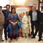 7 - IMAGE _ Gurinder Chadha with husband, family and Hugh Bonneville