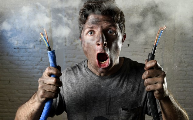 untrained electrocuted man plugging cable suffering electrical accident