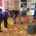 Commando Joe Ricky Atkins helping pupils with activity