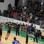 Lebanese League-Naseer (in blue) about to execute a  powerful smash