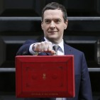 Britain's Chancellor of the Exchequer, George Osborne, holds up his budget case for the cameras as he stands outside number 11 Downing Street in central London