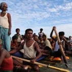 Rohingya refugees cross the Naf River with an improvised raft to reach to Bangladesh in Teknaf